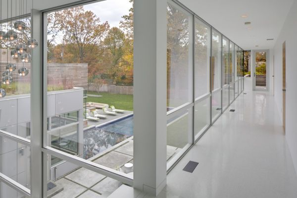White Structure Overview Outdoor Modern Lifestyle in Cleveland: Neat Rectangular House Embracing the Impeccable White