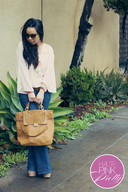 An Dyer wearing Sugarlips Apparel Ride the Caravan Top, Alice & Joy Camel Controversy Tote, Elizabeth & James Lafayette Sunglasses, Glint & Gleam Pink Gold Bracelets ShopLately, Frankie B Flared Jeans 2