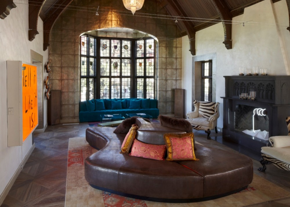 The great room truly lives up to its name, boasting a dramatic cathedral ceiling, arched buttresses and the home's original stained glass window.    Explore the home tour.