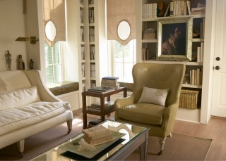 The library's calming neutral palette gets a masculine punch from ochre and dark green accents.