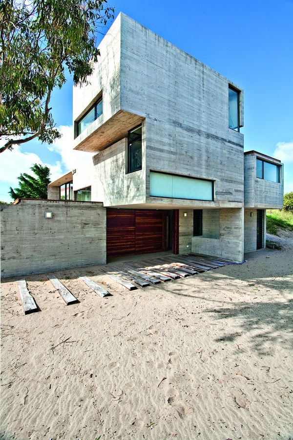 House with concrete elements Concrete House With Industrial Features on the Beach by BAK Architects