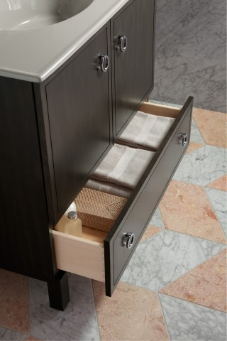 Jacquard® vanity     Jacquard ring pull     ANN SACKS® Carrara field tile     Running the full length of the vanity, this bottom drawer is just right for storing towels.