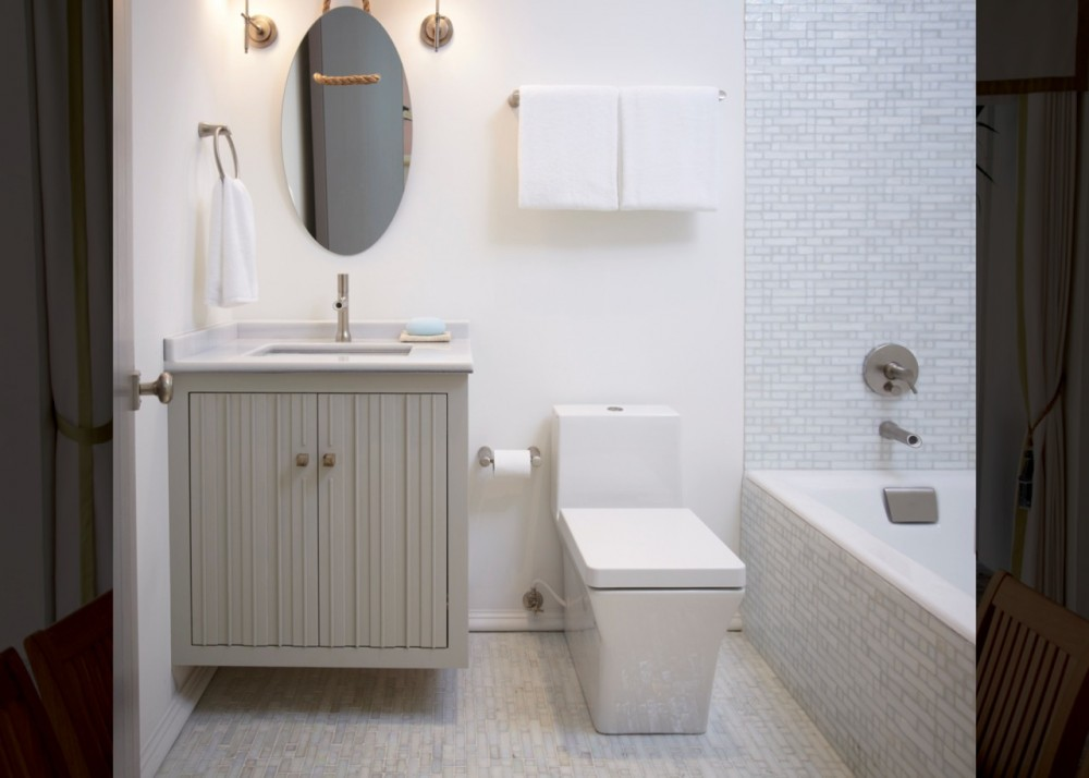 Toobi faucets and accessories   Rêve toilet   Tea-for-Two bath    The second-floor guest bathroom shares the home's mixed finishes and washed woods, but adds a modern twist with slightly sassy Toobi sink and bath faucets and the geometric Rêve toilet.