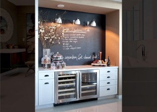 Beverage coolers and additional storage are tucked into a nook where blackboard paint and extra counter space are perfect tools for entertaining.    Explore the home tour.