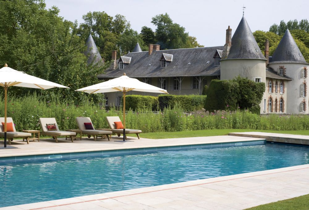 Traditional pool by mlinaric hernry zervudachi by architectural digest ad designfile home for Pool design france